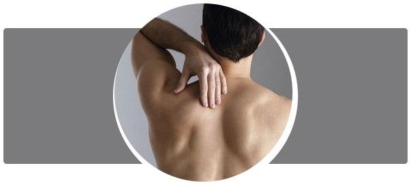 Из-за чего возникают боли в спине между лопатками?